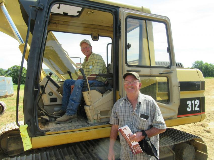 Jay Parkinson (L) of Mid-Ohio Wood and Rick Parlet of Smith Excavating, review the excavators up for sale.