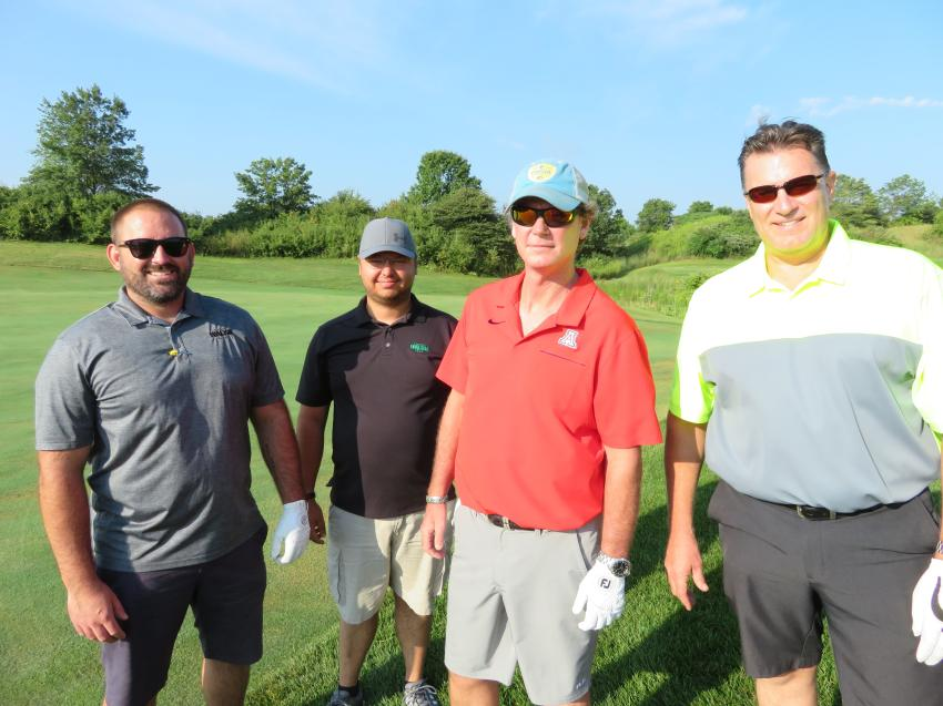On the course (L-R) are Kevin Berger, Ryan Wardinski and Terry Stanton, all of The Walsh Group, with John Hofmeyer rental coordinator of Alta Equipment.