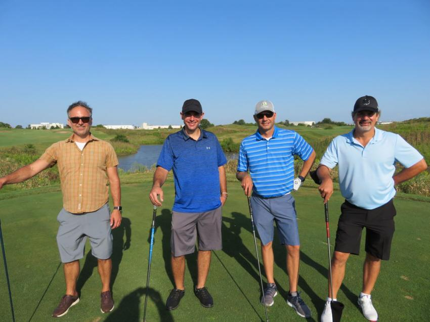 (L-R): The Premier Service team of Robert Pelino, Joe Menzione, Aaron Postma and Jason Postma are on the tee box.