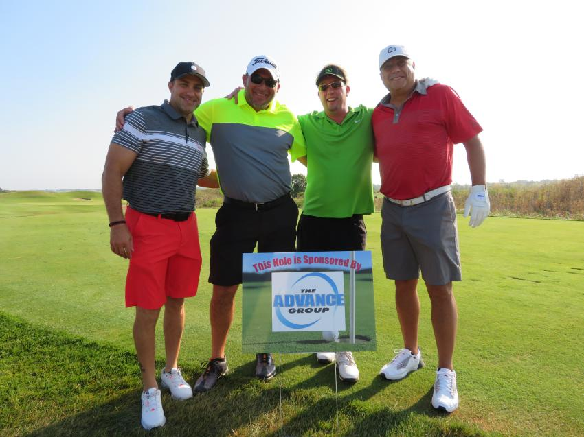 (L-R): At The Advance Group's sponsored hole are Bill Manolopoulos of The Advance Group; Mike Jaworski, director of sales of Alta Equipment; Scott Bloom of The Advance Group; and Peter Pavlopoulos of The Advance Group.