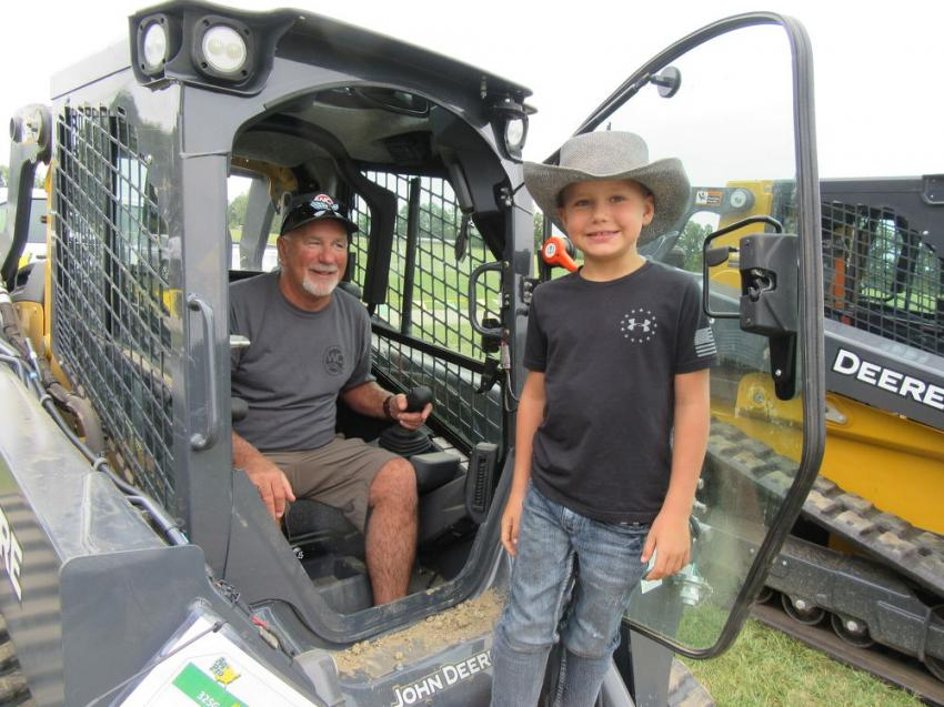 Jeff Watson (L) and grandson, Kingzton Watson, whose father owns Eastern Ohio Installers LLC, prepare to put this John Deere 325G compact track loader through its paces.