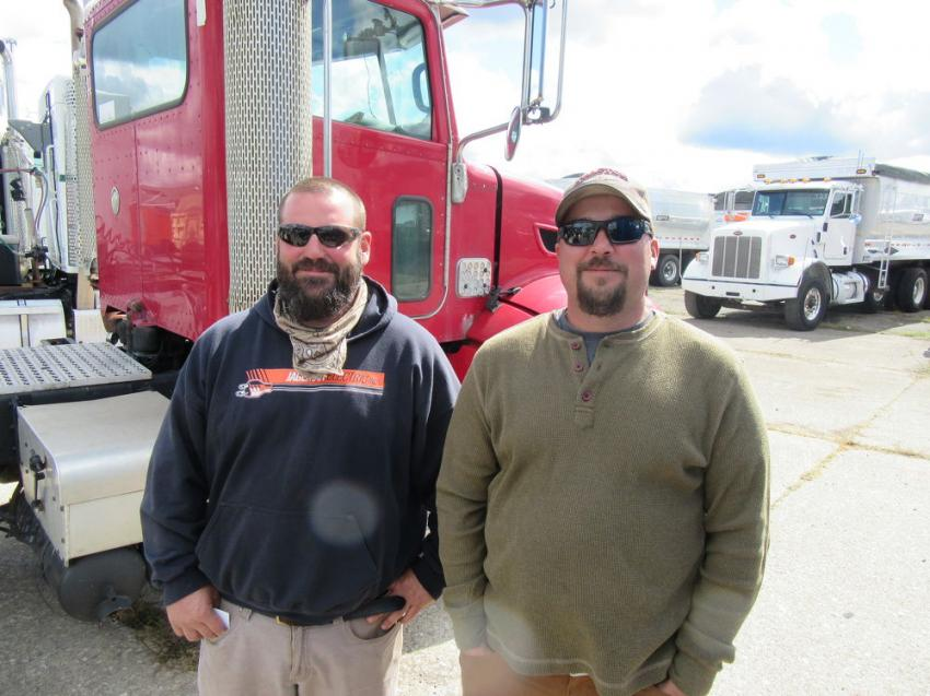 Waterford Paving & Construction's Josh Miller (L) and Justin Triscuit were on hand at the auction looking for equipment bargains.