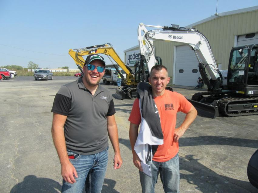 Joe Built Homes' Joe Corron (L) caught up with Joe Bennett of BB&D Painting, who purchased a Bobcat S530 skid steer.