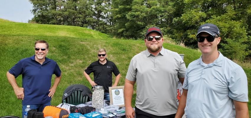 Finkbiner Equipment hosted hole #10 where a correct guess of the quantity of tees in the jug won a free screening machine rental. (L-R): Clyde Robison and Kyle Lucas of Finkbiner Equipment make sure Rich Mulder and Walt Nashert of Ozinga Materials & Logistics are entered to win.