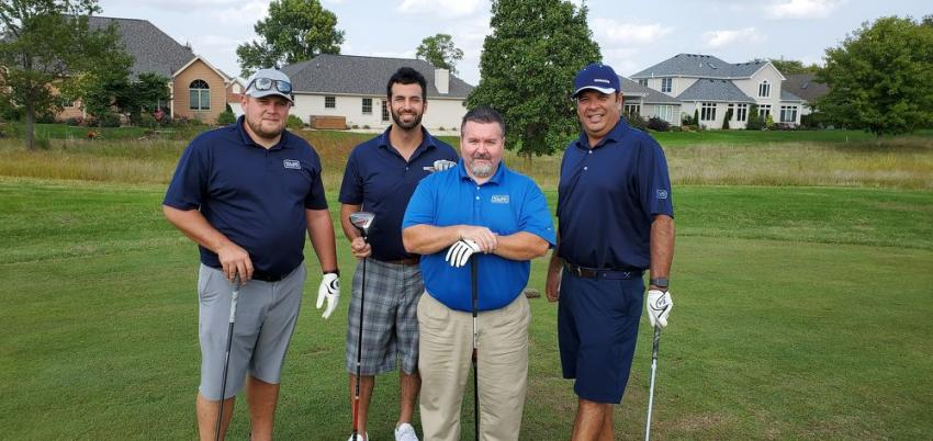Enjoying a day on the links is the Roland Machinery team of (L-R) Ed Ellis, Aaron Vargas, Cole Berringer and Mike McNamara, who are all ready to play golf.