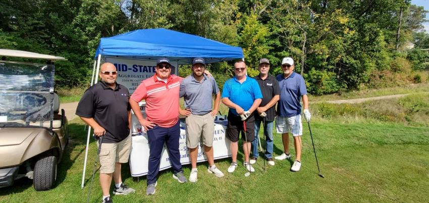 Mid-States Aggregate Equipment hosted a closest-to-the-pin competition at hole #17 with a Yeti cooler prize for the winner. (L-R) are Matt Bluemenstock of Horton Supply Company; Mike Jacob and Bill Jacob of Mid-States Aggregate Supply; Jim Sergent of Mid-America S&G; and Pat Biggs and Bob Biggs of Horton Supply.