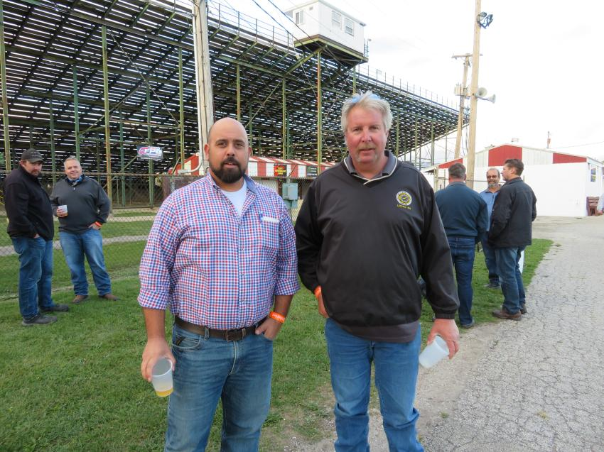 Adam Salinas (L), general manager of Illinois Truck and Equipment, and Ray Sundine of Local 150 Operating Engineers catch up during the event.