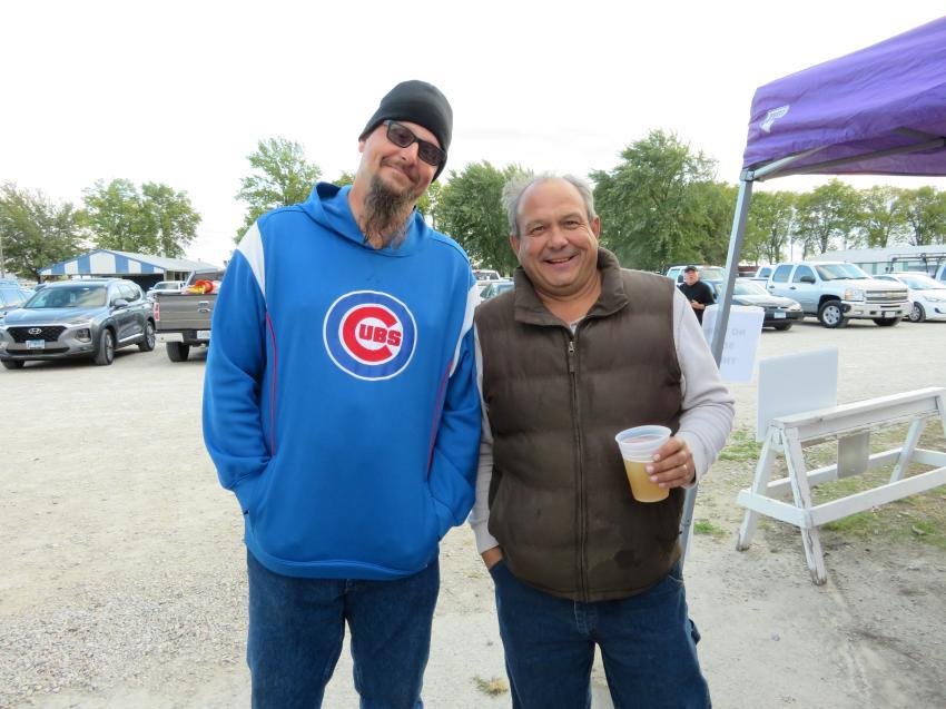 Matt Lane (L) volunteer at Oktoberfest, talks with John Young of Seasons Landscaping Inc., CAWGC  board member.