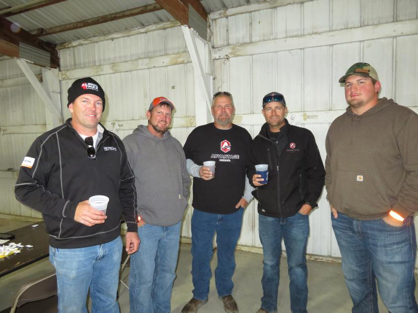 Enjoying the brats and burgers (L-R) are Nick Stipanovich of Illinois Truck and Equipment; Tedd Stipanovich of Stip Bros. Excavating; Mike Wisneski of Advantage Paving; Jeff Swanson, also of Advantage Paving; and Tom Younker of Brieser Construction Co.