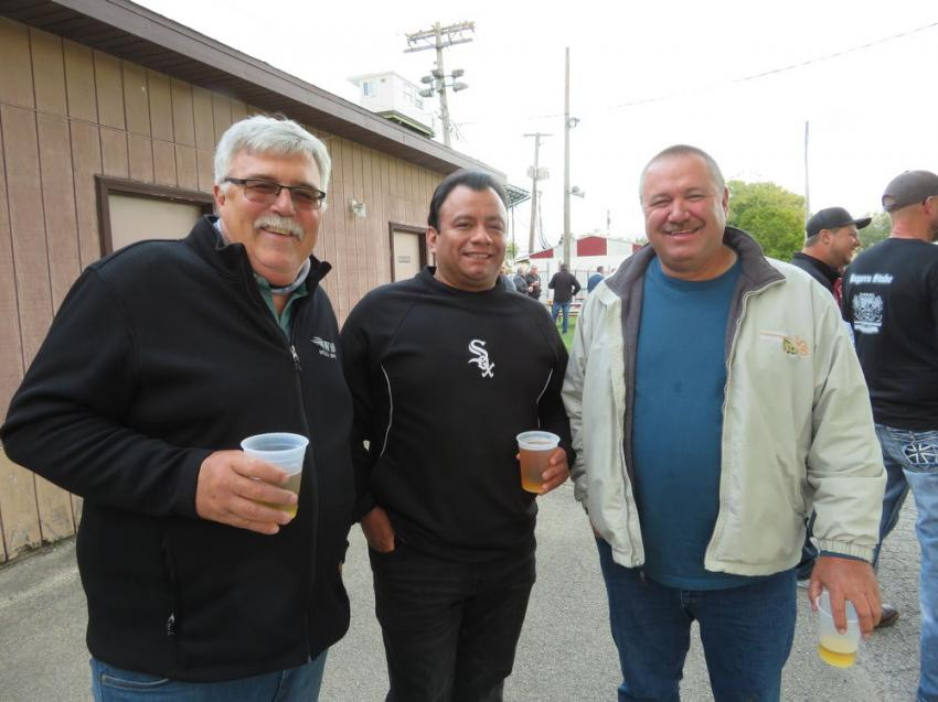 (L-R): Kevin Johnson and Paul Becerra, both of Welch Bros., and Joe Cox of Len Cox & Sons Excavating enjoy some refreshments.