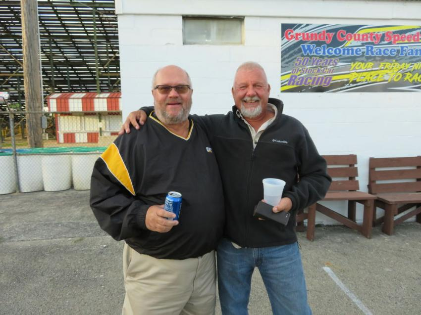 Old friends Tony Mattingly (L) of Altorfer Cat and Jody Foster of Welsch Ready Mix Inc. catch up at the Oktoberfest, held Oct. 1, at the Grundy County Fairgrounds.