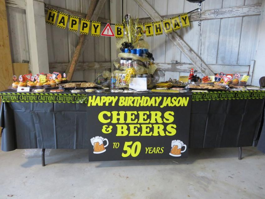 CAWGC staff members put together a table of treats to celebrate Jason Cox's 50th birthday. Cox is chairman of the board of the CAWGC Association.