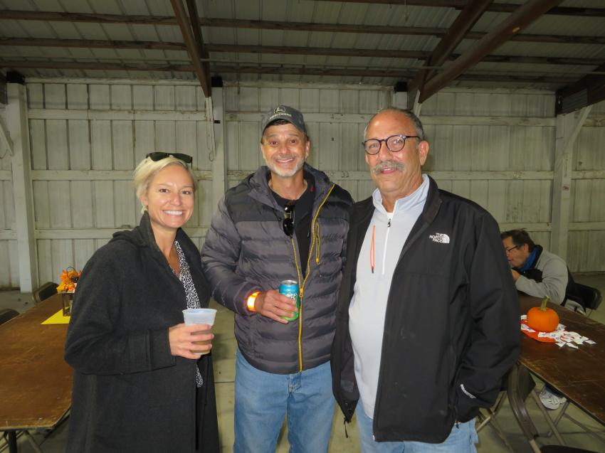 (L-R): Megan Hargrave, sales manager of West Side Tractor Sales Co., and Wayne Massad, also of West Side Tractor Sales Co., talk with Danny Sloan of Base Metals Group LLC.
