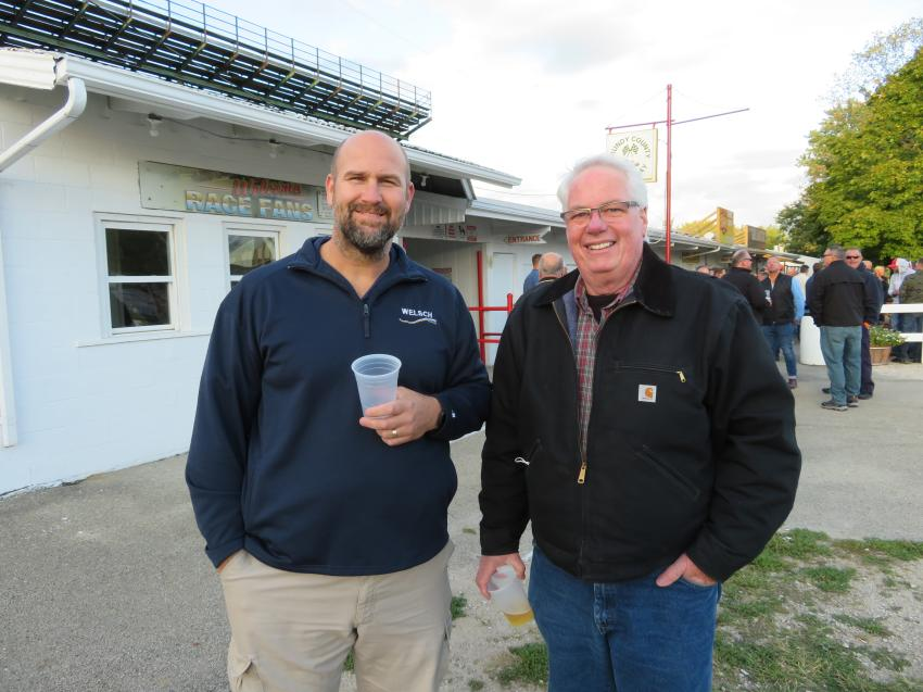 Mike Dejong (L) of Welsch Ready Mix Inc. and Bob Neville of Grundy Ready Mix talk some shop at the Oktoberfest.