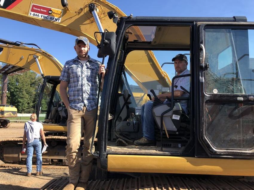 Looking over the excavators are Lee Adkins (L) and Coy Adams, both of Adams Lumber, Bobinsville, N.C.