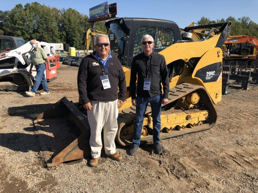 Jimmy Martin (L) of Martin Bros Construction, Gray Court, S.C., and Gary Seymore of Eco Waste Services, Greenville, S.C., both were interested the skid steer loaders and mini-excavators.