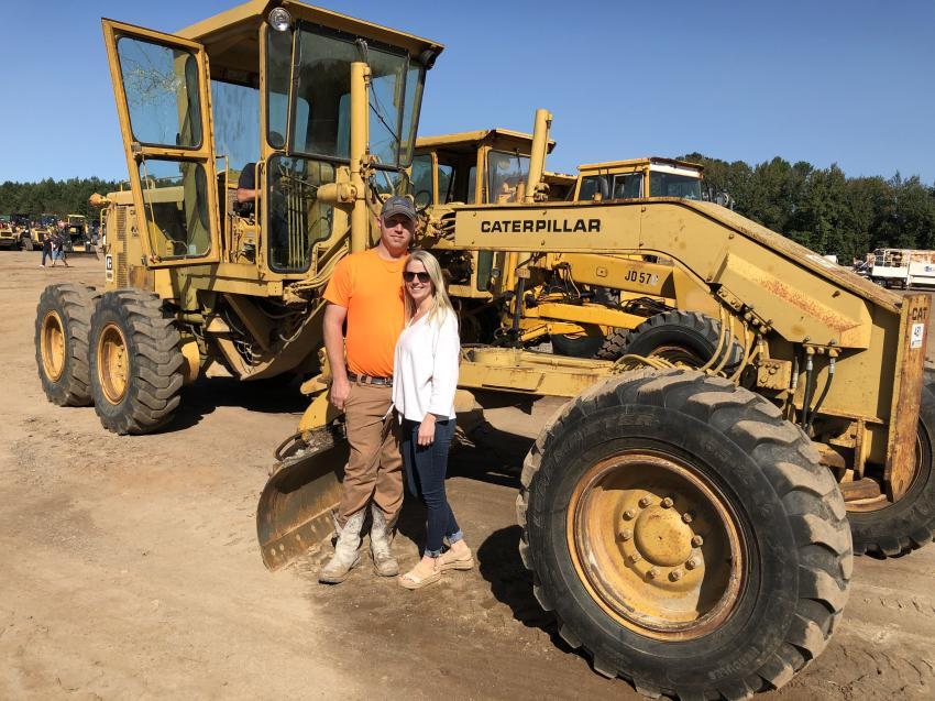 Charles and Kristen Wigington of Wigington Grading, Piedmont, S.C., looked over this Cat 12G motor grader.