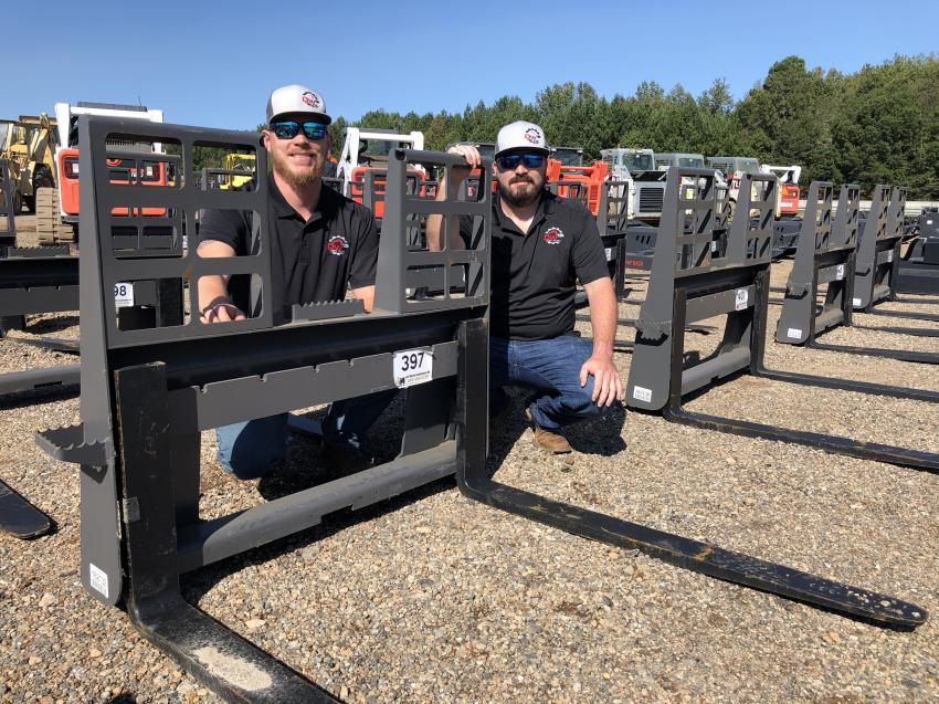 Chris Falls (L) and Chris Boyce, both of Dirt Wurx, Fountain Inn, S.C., looked over the selection of attachments.