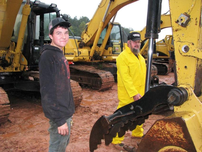 Dewey Collins (L) and his dad, Ron Collins, of Collins Grading, Auburn, Ga., carefully inspect some excavators of interest before the bidding begins.