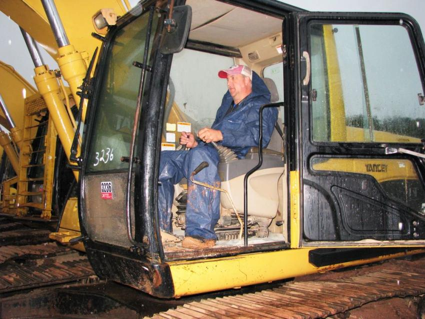 Jeff Banks of Sticks & Bricks Inc., a commercial contractor based in Marietta, Ga., test operates a Cat 320CL excavator before the auction gets under way.