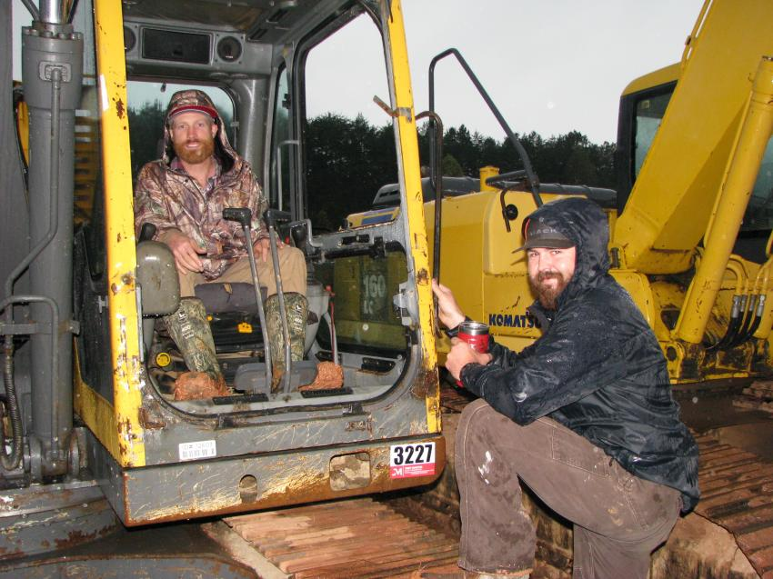 Discussing their thoughts on the excavators in the sale line-up are TJ Jones (L) of TB Contracting, Canton, Ga., and Ben Weatherby, independent dealer, Canton, Ga.