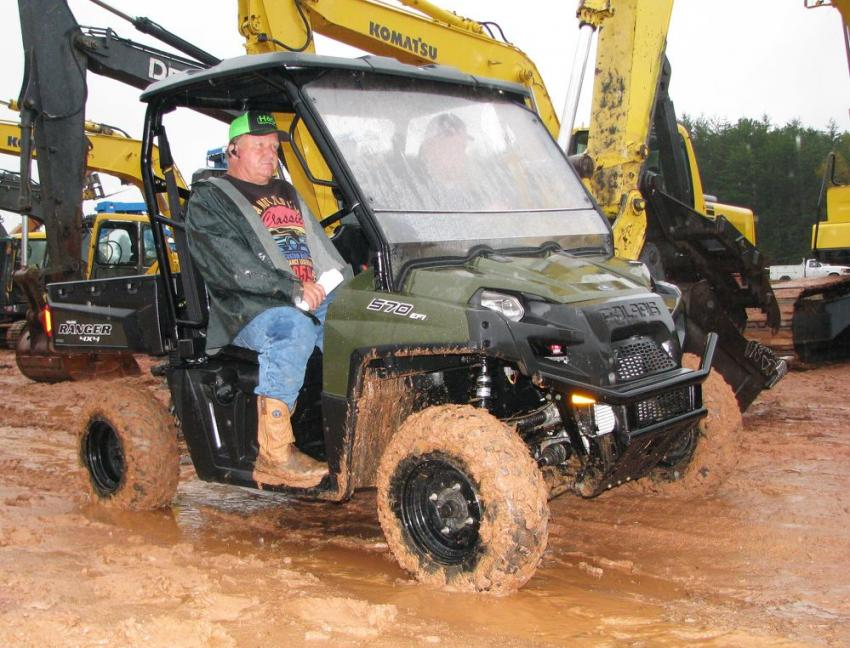 Checking out some of the machines from the comfort of their Polaris Ranger 4-wheeler are Garry (L) and Kevin Holcomb of Holcomb Construction, Hiawassee, Ga.