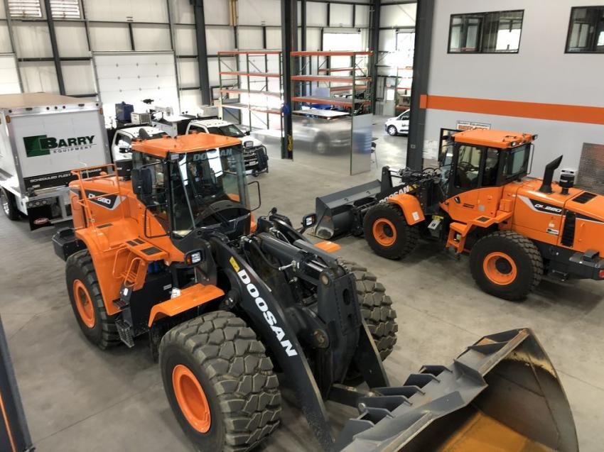 Barry Equipment new facility has room to spare for prepping and servicing machines like these two Doosan loaders, a model DL580-5 and DL280-5, being prepped for delivery.