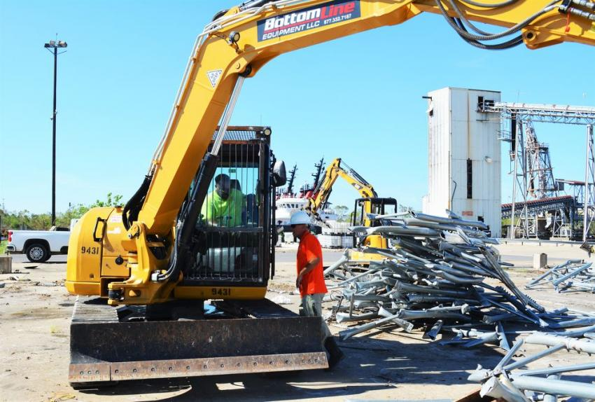 It's a team effort for Bottom Line Equipment as heavy equipment operators help with the cleanup effort in the aftermath of Hurricane Laura.