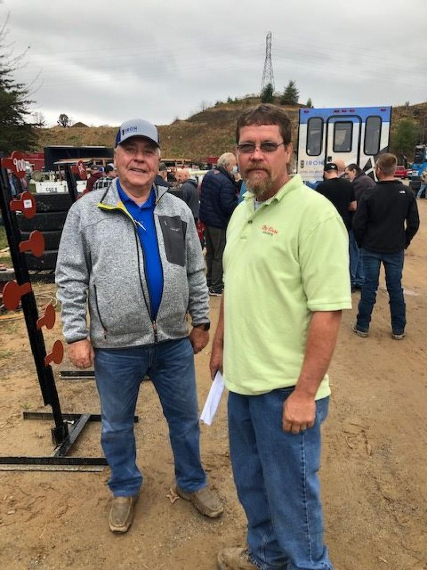 Terry McGaffee (L) and Jason Herndon, McClure Concrete Products Inc., were ready to place some bids.
