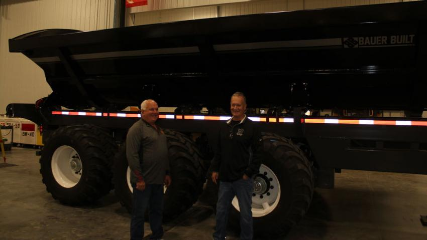 """Gary Crabs (L) of AGE in Erlihm, Iowa, talks with Mark Swedlund, one of Mid Country Machinery's dealer principles, about one of the newest pieces of equipment added to the Mid Country lineup — a Bauer Built heavy-duty side dump trailer. Crabs said he has two of these heavy-duty trailers and can run them in tandem. He said these are versatile and the heaviest built trailer has ever used. """"It is bullet proof,"""" said Crabs. """"I absolutely love this trailer."""""""