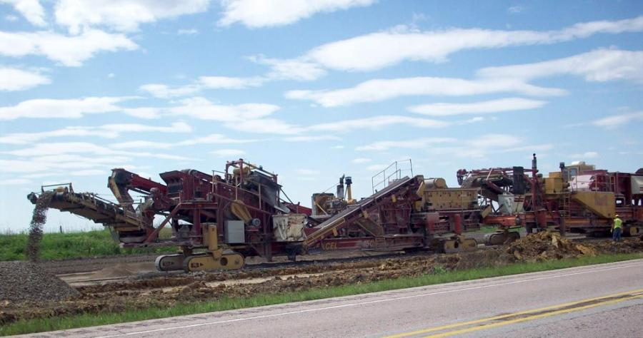 The tail end of Manatt's Paradigm crusher is windrowing the final product, granular subbase, onto a finished shoulder grade. Later, the materials were pulled over the surface and spread out as a subbase.