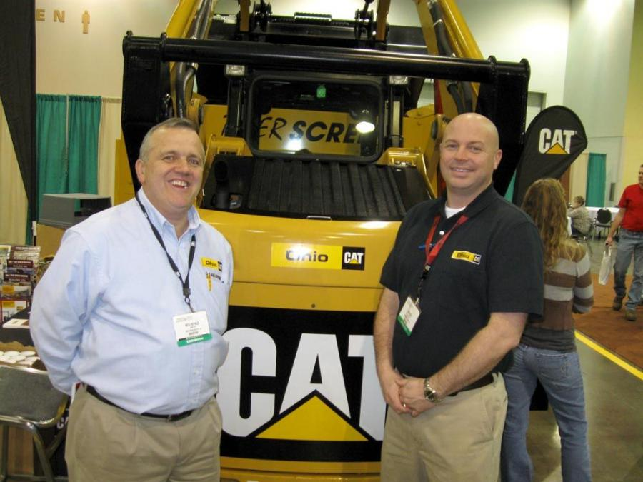 Ned Herald (L) and Rob Cox of Ohio CAT discuss material handling and screening equipment with attendees.