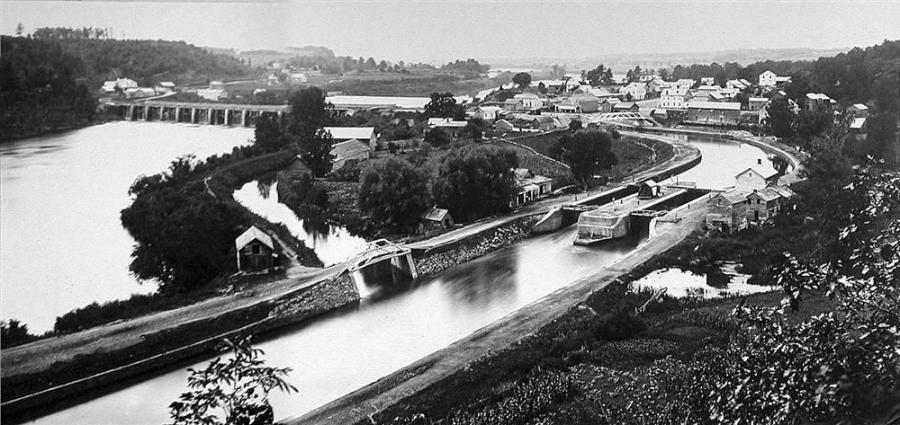 A stone aqueduct of the Erie Canal crosses the Mohawk River in Rexford, New York.