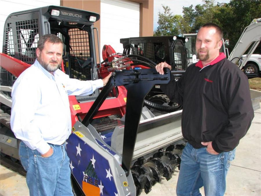 Allen Tennis (L), territory manager of FAE USA Midwest, and Wes Oller of The Victor L. Phillips Co., Brookline Station, Mo., talk about the UML SSL 150VT .