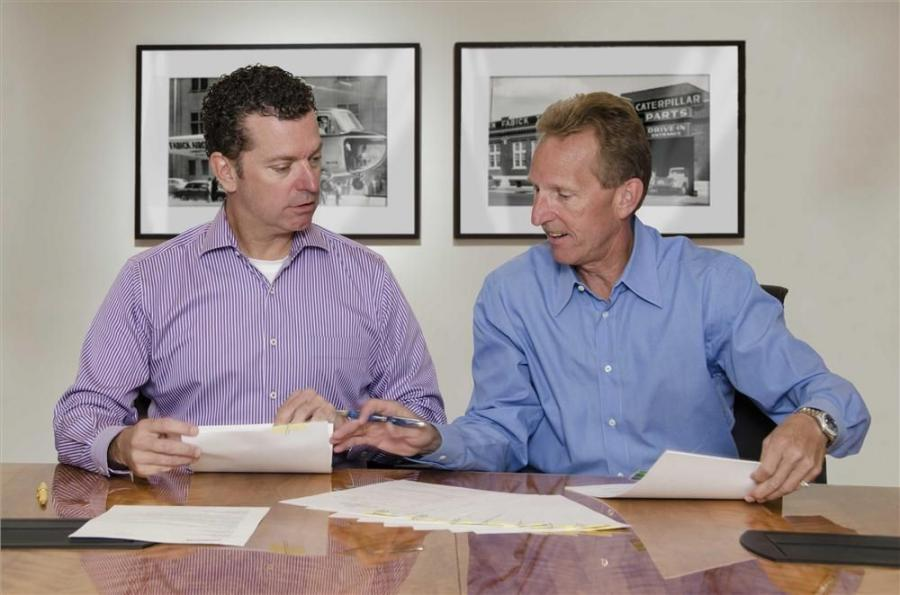 Doug Fabick and Jeré Fabick (right) finalize the agreement.