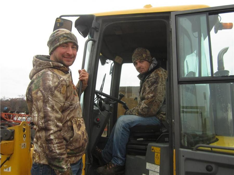 John Kleiber (L) and Ryan Lindbert, both of Prolawn & Landscaping, check over this Volvo L 35B compact wheel loader.