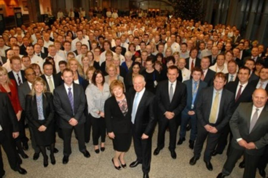 JCB CEO, Alan Blake (front, center) with his wife Diane at his retirement presentation.