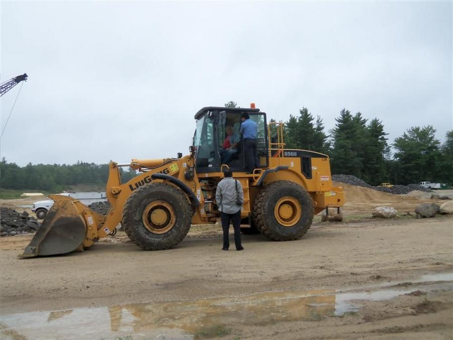 R&D engineers from the wheel loader factory in China visit an Equipment East customer in New Hampshire.