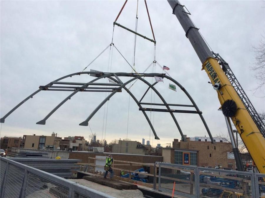 The new bridge at Milwaukee Avenue features arches and used recycled steel from the old bridge.