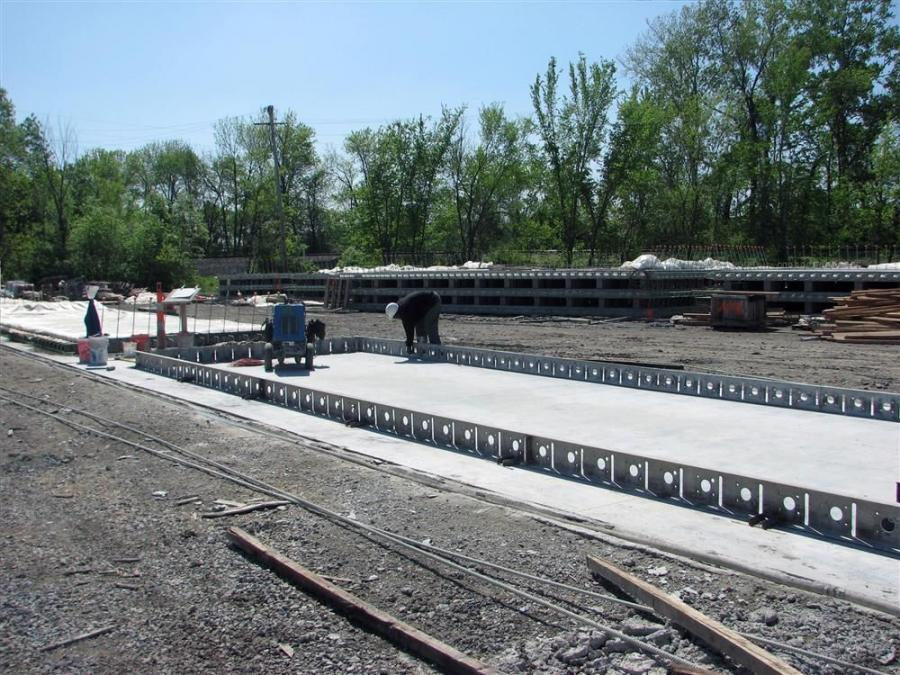 Crews work in the yard to build the massive panels used as part of the driving surface for the NMRB.