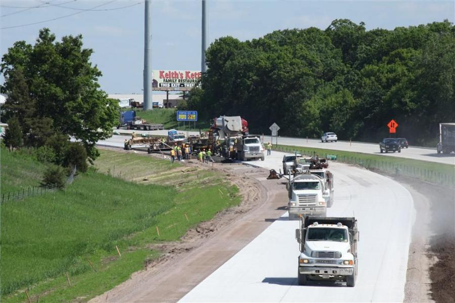 Road crews pave the section of road shoulder on the eastbound lanes of I-94 near St. Cloud, Minn., in June and opened up all four lanes of the freeway to traffic in time for the July 4th holiday.