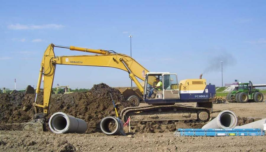A Komatsu PC400LC excavator moves earth away to prepare for future pipework.
