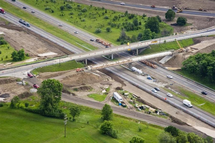 Crews with Fonson Inc, of Brighton, Mich., work on a two-lane bridge that spans U.S.-23 in Ann Harbor, Mich. The bridge is part of a $5.3 million improvement project to help relieve congestion on Interstate 23. Setting the bridge beams was done at night t