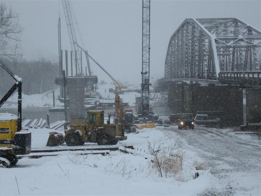 Crews with Lunda Construction of Black River Falls, Wis., work on pile driving during December 2009 on the new bridge at Drayton, N.D., that makes it possible for traffic to cross between North Dakota and Minnesota. Crews battled frigid weather and floodi