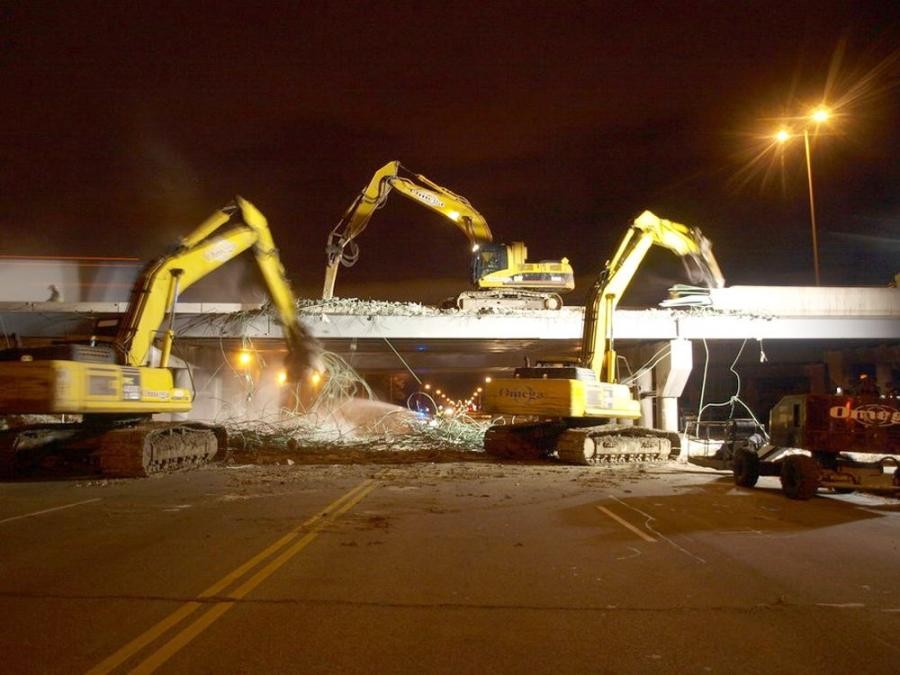 Crews work at night to demolish a bridge along a 35-mi. (56.3 km) section of Interstate 94 in Wisconsin from the Illinois state line to Milwaukee