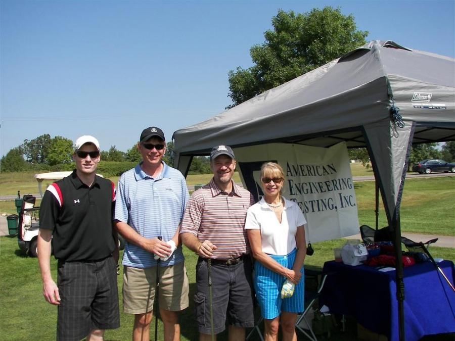 (L-R): At the American Engineering & Testing sponsored hole, C.J. Becker and Jim Fink of M & I Bank, Mike Aydt of MP Nexlevel, Maple Grove, Minn., and Barbara Nieland, also of M & I Bank, get ready to tee off.