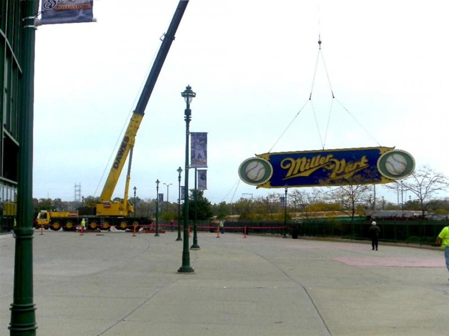 A crane from Dawes Rigging & Crane Rental of Milwaukee lifted the 15,000-lb., 15 by 75-ft. sign and its 17,000-lb. steel framing from its place above the current scoreboard to make room for a new scoreboard system that will include a built-in Miller Park