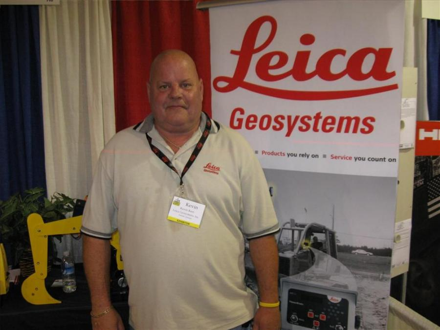 Kevin Kerr welcomes attendees to Leica Geosystems' exhibit.