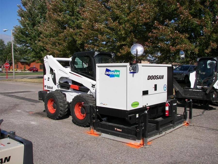 Shown above is the Doosan G40 heating unit attached to a Bobcat S850 skid steer heating up the asphalt to be reclaimed.
