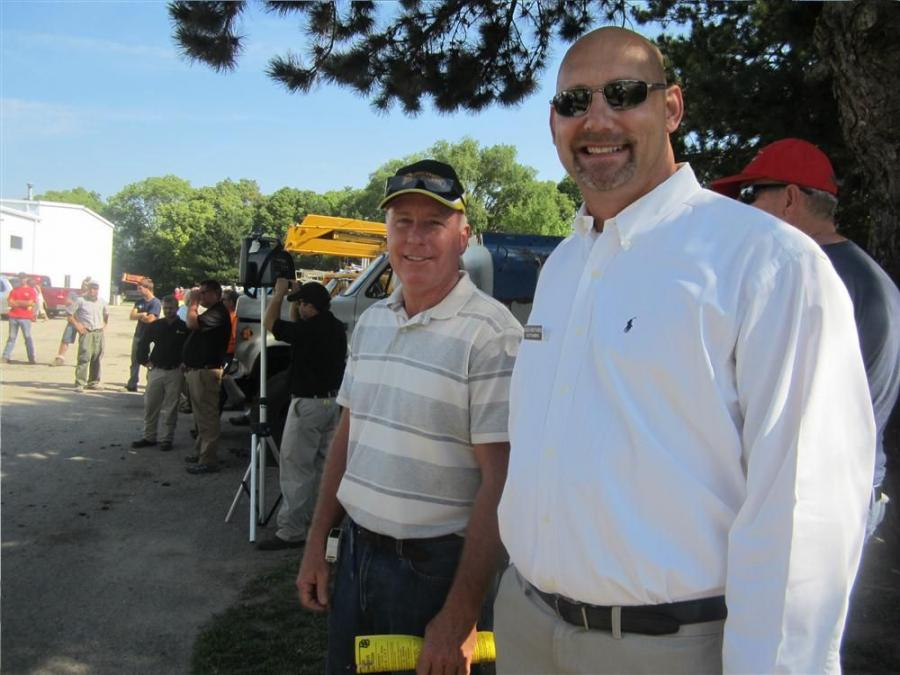Carl Hoerr (L), president of Hoerr Machinery Co., and Lynn Schroeder, Hilco Global, compare notes at the East Peoria, Ill., sale.